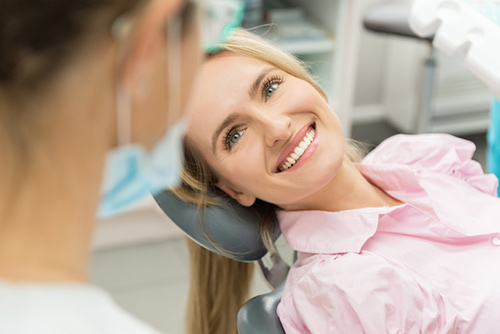 A smiling patient during periodontal treatment
